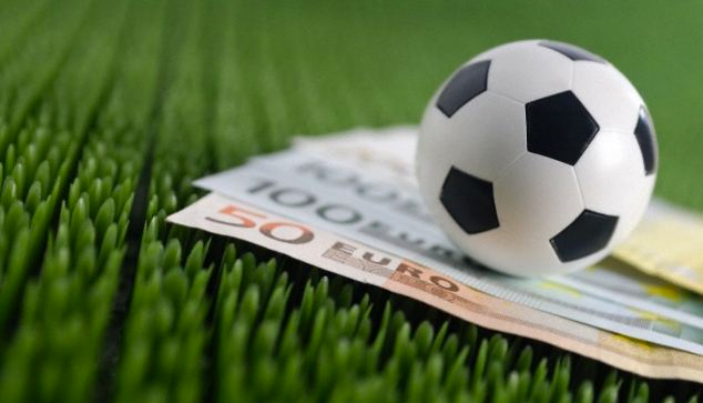 Soccer ball on top of Euro bank notes